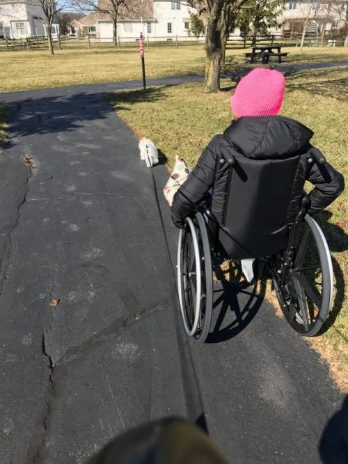 Cori Fischer in wheelchair as she adapts to movement disorder A GUEST POST BY CORI FISCHER